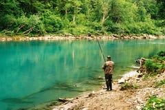 Pescatore sul fiume Cesalpina Fotografie Stock