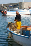 Pescatore sul lavoro Immagini Stock