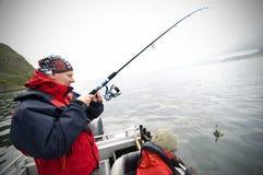 Pescatore sulla barca Fotografia Stock