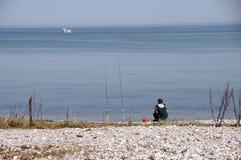 Pescatore sulla spiaggia fotografia stock