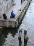 Pescatore in vecchia porta Fotografie Stock