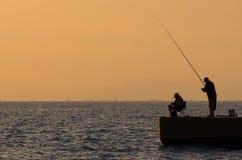 Pescatori al tramonto Fotografia Stock
