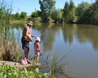 Pescatori di prima generazione con la nipote Fotografie Stock Libere da Diritti