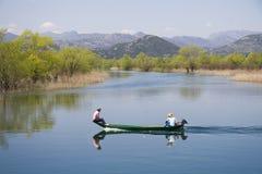Pescatori nel lago Fotografia Stock