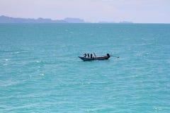 Pescatori in una barca fotografia stock
