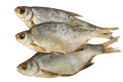 Pesce affumicato su un fondo bianco Fotografia Stock