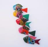 Pesce di legno brillantemente dipinto Fotografie Stock Libere da Diritti