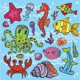 Pesce divertente del fumetto, insieme di vita di mare Scarabocchio colorato Fotografia Stock