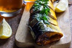 Pesce e birra affumicati Immagini Stock