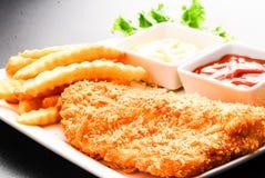 Pesce e patate fritte tailandese di stile Immagine Stock