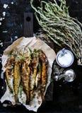 Pesce fritto con il teriyaki ed i rosmarini Fotografia Stock