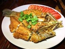 Pesce fritto nel grasso bollente Immagini Stock Libere da Diritti