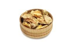 Pesche secche in un piatto di legno Fotografia Stock
