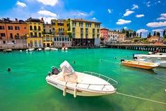 Peschiera del Garda colorful harbor and boats view. Lago di Garda, Veneto region of Italy stock images