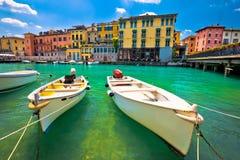 Peschiera del Garda colorful harbor and boats view. Lago di Garda, Veneto region of Italy royalty free stock photos