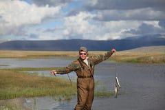 Pesci di cattura del pescatore Fotografie Stock