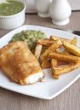 Pesci e chip Immagini Stock Libere da Diritti