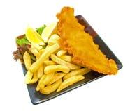 Pesci e chip sulla zolla Fotografia Stock