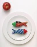 Pesci e mela di dieta Fotografie Stock