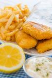 Pesci e pasto dei chip Immagini Stock