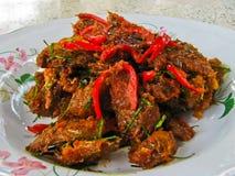 Pesci fritti con l'inserimento del curry Immagini Stock