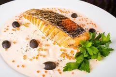 Pesci fritti con le olive Immagine Stock