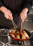 Pesci fritti cuoco unico Immagine Stock