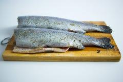 Pesci sul bordo di taglio Fotografia Stock