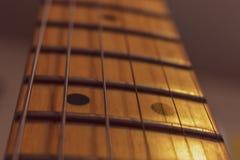 Pescoço da guitarra elétrica e placa da fricção imagem de stock royalty free