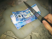 1000 peso bills. Chop up your money stock photography