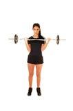 Peso de elevación de la muchacha adolescente. Imagen de archivo