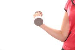 Peso de la pesa de gimnasia de la hembra que se encrespa Fotos de archivo libres de regalías