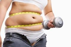 Peso gordo da terra arrendada da mulher ao exercício Imagem de Stock Royalty Free