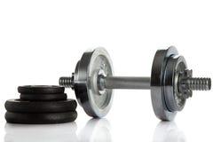 Peso isolado no gym branco do fundo Fotografia de Stock