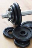 Pesos & peça do dumbell Imagem de Stock