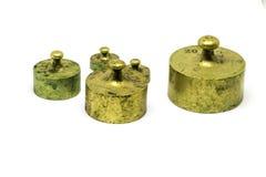 Pesos de bronze antigos da calibração isolados no fundo branco Fotos de Stock Royalty Free