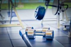 Pesos de la pesa de gimnasia Imágenes de archivo libres de regalías