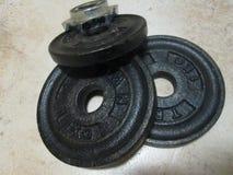 Pesos de la pesa de gimnasia Fotografía de archivo libre de regalías