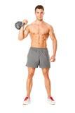 Pesos de levantamento do homem muscular novo no branco Imagem de Stock