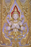 Pesque la escultura con caña en la pared en templo público Imagen de archivo libre de regalías