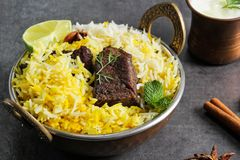 Pesque peixes e o arroz indianos do estilo de Biryani com masala picante foto de stock royalty free