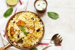 Pesque peixes e o arroz indianos do estilo de Biryani com masala picante fotografia de stock