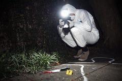 Pesquisador do forense Imagens de Stock