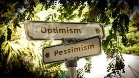 Pessimism f?r optimism f?r gatatecken kontra royaltyfria bilder