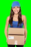 Pessoa da entrega que guarda pacotes Fotografia de Stock Royalty Free
