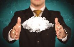 Pessoa das vendas que guarda a nuvem branca Imagens de Stock Royalty Free