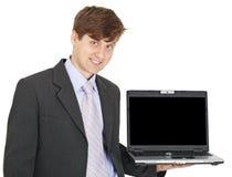 A pessoa de sorriso amigável prende o portátil na mão Foto de Stock