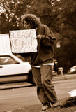 Pessoa desempregada que pede a ajuda Imagens de Stock
