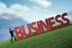 Pessoa do negócio que empurra a palavra do negócio 3D subida Imagem de Stock
