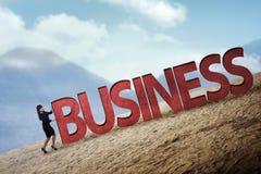Pessoa do negócio que empurra a palavra do negócio 3D subida Imagem de Stock Royalty Free